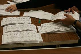 Ballot-papers-in-piles-with-hands-s