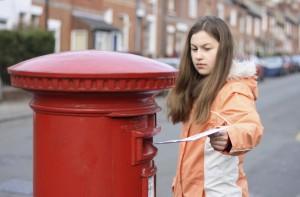 girl posting letter
