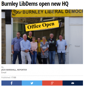 Picture of Burnley Liberal Democrats outside of their new office